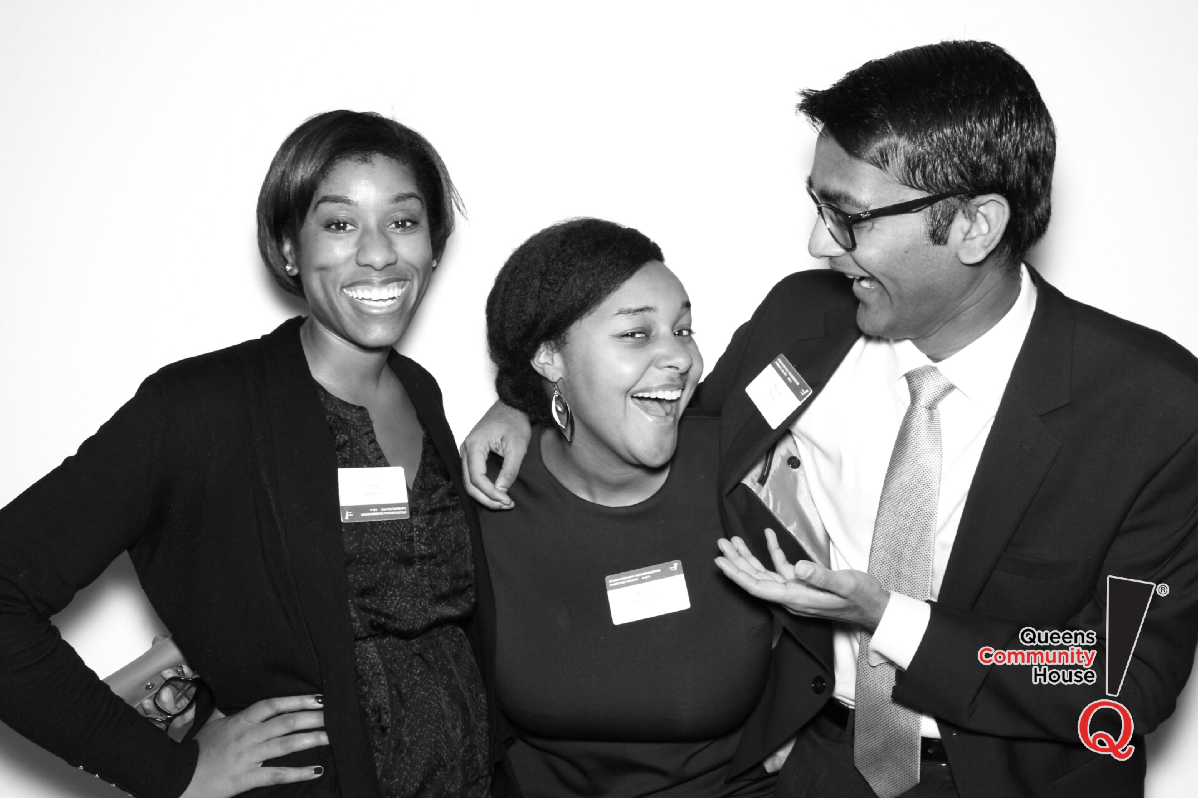 Three people smiling and laughing