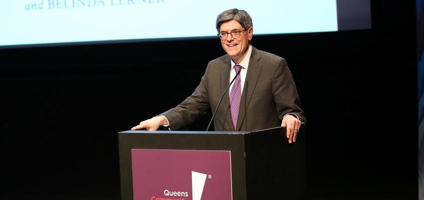 Man presenting at a podium
